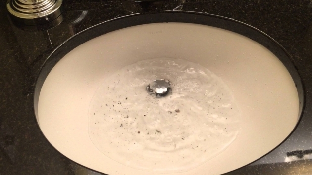 Image of Bathtub Backed Up Clogged Kitchen Sink Drain Causes Back Up At Master Bathroom Sink
