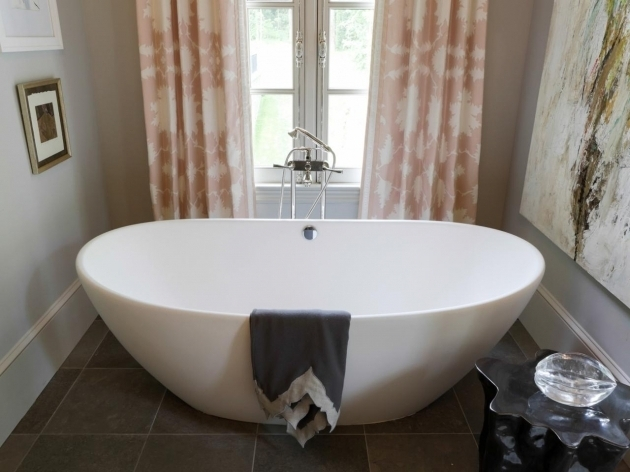 Deep soaking tub freestanding combo of shower and deep for Extra long soaking tub